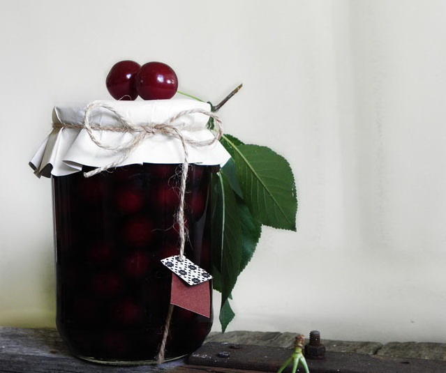pop-top jar of sour cherries